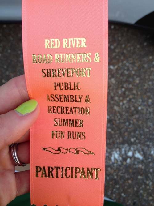 Participant ribbon from one of the local summer fun runs.